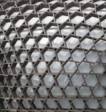 Hexagonal wooden structure, covering a building. Abstract. Close up view of hexagonal wooden design, used to cover a building below with the light making stock photography