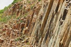 Hexagonale kolommen van vulkanische oorsprong in Hong Kong Global Geopark in Hong Kong, China stock foto's