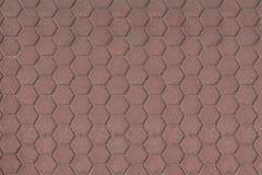 Hexagone urbain, modèle rougeâtre de plats de plancher photos stock