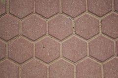 Hexagone urbain, modèle rougeâtre de plats de plancher images libres de droits