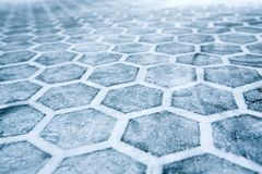 Hexagons. A big white paper on a dirty ground after some pressure Stock Photos