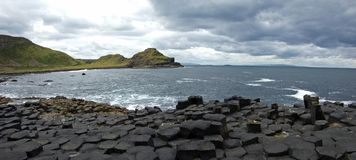 Hexagons in Giant's Causeway - panoramic view Stock Image