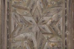 Hexagram gebildet von den hölzernen Planken Detail des alten hölzernen Fensters Stockbild