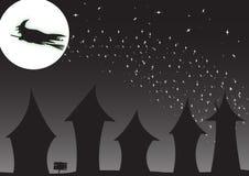 Hexe über Häusern Lizenzfreies Stockfoto