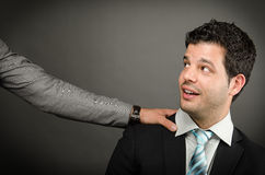 Hey Boss. Image of young business man with an arm on his shoulder Royalty Free Stock Photos