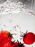 Hey fresh and cool fruites jumping in cold water. Water drops and motion Royalty Free Stock Photography