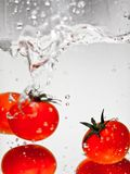 Hey fresh and cool fruites jumping in cold water. Water drops and motion Royalty Free Stock Photo