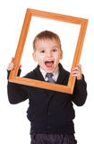 Hey, I am here. Shouting caucasian boy, holding a wooden picture frame. Isolated on white background Royalty Free Stock Image
