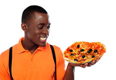 Hey lets enjoy some yummy pizza Stock Image
