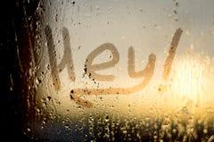 Hey palavra na janela misted Fotografia de Stock