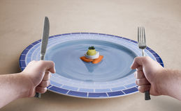 Hey! Where is my food?. Holding silverware in front of a dish in first person perspective Stock Image