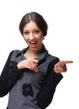 Hey, You!. Portrait of a young happy girl pointing at you over white Stock Photo
