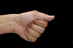 Hey You. Pointing finger on black background stock photo