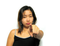 Hey You!. Asian girl pointing finger (focus area on finger stock images