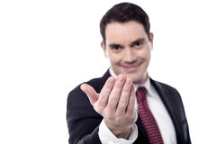 Hey you, come over here. Smiling businessman hand beckoning someone Stock Image