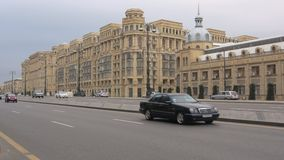 On Heydar Aliyev Avenue on a cloudy January day. Baku. BAKU, AZERBAIJAN - JANUARY 05, 2018: On Heydar Aliyev Avenue on a cloudy January day stock footage