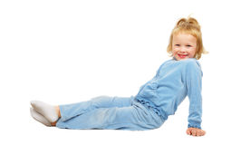 Hfppy little beutiful girl sitting on the floor. Royalty Free Stock Photos