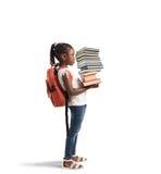 Hög av böcker för lite flicka Royaltyfria Bilder
