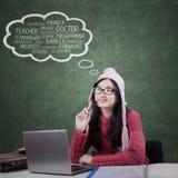 Högstadiumstudenten tänker hennes dröm- jobb Arkivfoto