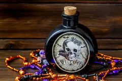 HHalloween background of vail of poison and an assortment of voodoo bead on a dark wooden table stock photo