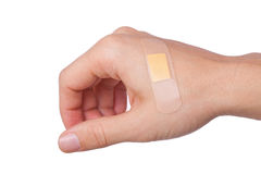 Hhand with Adhesive Bandage Royalty Free Stock Image