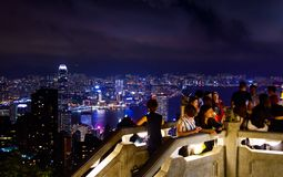 Hhong Kong - August 8, 2018: Tourists enjoying Hong Kong cityscape view from the Victoria peak royalty free stock photo