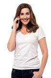 Hi darling, how are you ?. Smiling woman talking on her cell phone Royalty Free Stock Photography