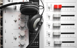 Hi-fi sound guard headphones over portable sound mixer Royalty Free Stock Image