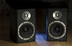 Hi-fi speakers. Stereo speakers on hardwood floor Stock Images