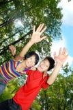 Hi or goodbye. Photo of the cheerful boy and girl saying helo or goodbye stock photography