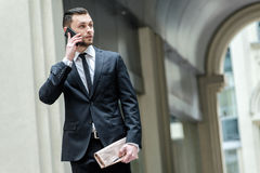 Hi! Hello! Confident businessman standing in the street and talk Stock Images