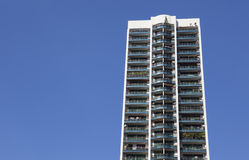 Hi rise condominium on clear blue sky Stock Photos