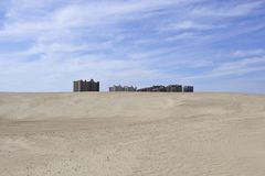 Hi rise towers contrast sandy desert, Mexico Royalty Free Stock Photo