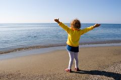 Hi the sea!. The little girl is admired by sea Stock Photos