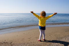 Hi the sea!. The little girl is admired by sea Stock Photography