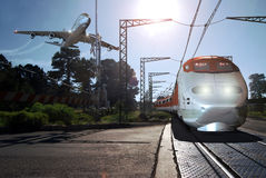 Hi-speed transportation. A big plane flying above a modern high-speed train on its railroad, representing two of the most importants means of  transportation by Stock Images