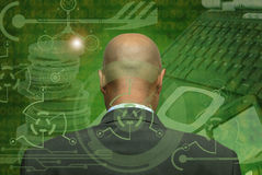 Hi-tech. Man's head in green background with numbers and hi-tech symbols royalty free stock photo