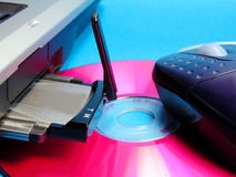 Hi tech. Wireless INTERNET card in it computer slot,CD,and mouse Royalty Free Stock Photography