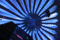 Hi-tech blue. Blue lighting on contemporary roofing structure Stock Photos