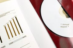 Receive Annual Report by DVD. Hi tech Company Annual Report for share holders recorded in DVD - A photograph showing a set of CD and annual report figures and Stock Images