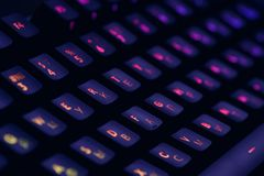 Hi tech computer mechanical keyboard with backlight rgb illumination. Close up of computer gaming accessory. royalty free stock images
