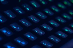 Hi tech computer mechanical keyboard with backlight rgb illumination. Close up of computer gaming accessory. Hi tech computer mechanical keyboard with backlight royalty free stock photography