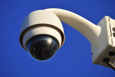 Hi-tech dome type camera over blue sky Stock Photos