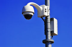 Hi-tech dome type camera over blue sky Royalty Free Stock Photo