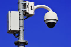 Hi-tech dome type camera over blue sky Stock Photos