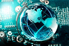 Hi-tech earth globe. Against circuit background royalty free stock photo