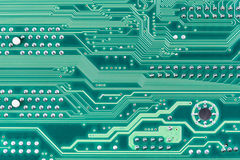 Hi-tech electronic circuit board green background Stock Image