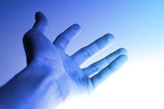 Hi-Tech Hand Background. Backlit shot from bottom, intentional highlight. Selective focus stock photo
