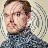 Hi-tech portrait of young man. Stock Photos