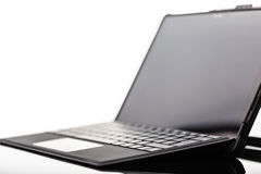Hi-tech sleek laptop Stock Photography